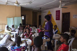 "Young girls listen to an educational talk at the Bada Primary Health Centre in Lagos, Nov. 11, 2018. The ""9ja Girls"" is a program aimed at helping young Nigerian girls prepare for adulthood through educational programs and family planning."