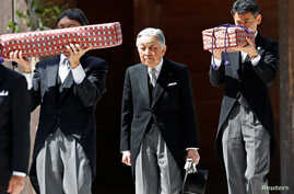 FILE - Japan's Emperor Akihito, flanked by Imperial Household Agency officials carrying two of the so-called Three Sacred Treasures of Japan, leaves the main sanctuary as he visits the Inner shrine of the Ise Jingu shrine, ahead of his April 30, 2019...