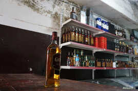 A bottle of whiskey is seen inside a liquor shop, after it was banned during the Islamic State militants' seizure of the city, in Mosul, Iraq, April 20, 2019.