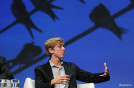 FILE -Chris Hughes, co-founder of Facebook, speaks at a conference in Boston, Massachusetts.