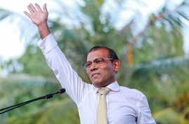 Former president of the Maldives Mohamed Nasheed waves as he addresses the country after returning from exile to the Maldives, in Male, Nov.18.