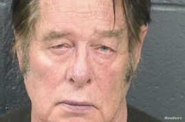Larry Hopkins appears in a police booking photo taken at the Dona Ana County Detention Center in Las Cruces, New Mexico, April 20, 2019.