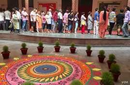 Voters line up at polling booths in the capital New Delhi where voting was held Sunday in the second last round of India's staggered general election.