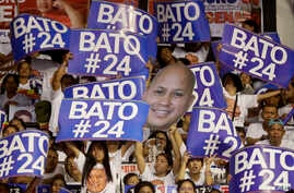 "Supporters raise their posters to cheer their senatorial candidate, former national police chief Rogelio ""Bato"" Dela Rosa during the last campaign rally by the administration for the midterm elections in suburban Pasig city east of Manila, Philippine..."