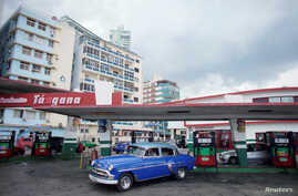 A vintage car leaves a gas station operated by Cimex corporation in Havana, Cuba, May 3, 2019.