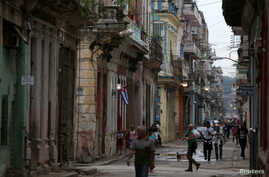 People walk on a street in Havana, Cuba, Apr. 10, 2019.