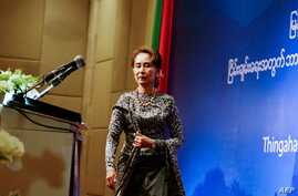 Aung San Suu Kyi takes the stage May 7 at a forum for National Reconciliation for Peace in Myanmar