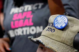 FILE - Planned Parenthood supporters display their views during a rally on the steps of the Capitol in Jackson, Miss., March 14, 2019.