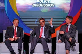 U.S. Energy Secretary Rick Perry, center, speaks as Utah Gov. Gary Herbert, left, and and Wyoming Gov. Mark Gordon look on at an energy summit, May 30, 2019, in Salt Lake City. (AP Photo/Rick Bowmer)