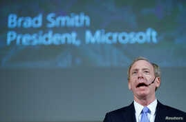 """FILE - Brad Smith of Microsoft takes part in a panel discussion """"Cyber, big data and new technologies. Current Internet Governance Challenges: What's Next?"""" at the United Nations in Geneva, Nov. 9, 2017."""