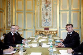 Facebook CEO Mark Zuckerberg (L), and French President Emmanuel Macron meet at at the Elysee Palace, in Paris, May 10, 2019.
