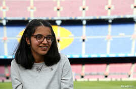 "Syrian refugee Nujeen Mustafa poses after a charity Christmas event ""Nujeen's dream"" at Camp Nou stadium in Barcelona, Spain, Dec. 14, 2017."