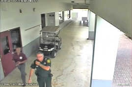 Then-Broward County Sheriff's Deputy Scot Peterson, who was assigned to Marjory Stoneman Douglas High School during the February 14, 2018 shooting, is seen in this still image captured from the school surveillance video released by Broward County She...