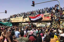 Protesters rally at a demonstration near the military headquarters in the capital Khartoum, Sudan, April 9, 2019.