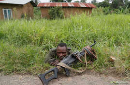 FILE - A Democratic Republic of the Congo soldier rests next to a road in North Kivu province, Democratic Republic of Congo, Dec. 11, 2018.