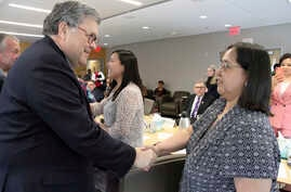 U.S. Attorney General William Barr, left, greets Vivian Korthius with the Association of Village Council Presidents at a roundtable discussion at the Alaska Native Tribal Health Consortium, May 29, 2019, in Anchorage, Alaska, where participants disc...