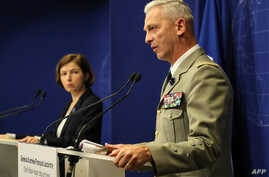 French army chief of staff general Francois Lecointre, right, and French Defense Minister Florence Parly give a press conference in Paris, May 10, 2019, as French forces freed two French hostages as well as an American and a South Korean in northern ...