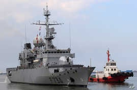 FILE - Tugboat escorts French Navy frigate Vendemiaire on arrival for a five-day goodwill visit at a port in Metro Manila, Philippines March 12, 2018.