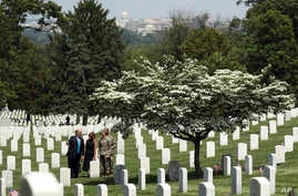 President Donald Trump and first lady Melania Trump visit Arlington National Cemetery, May 23, 2019, for the annual Flags In ceremony ahead of Memorial Day, in Arlington, Va.