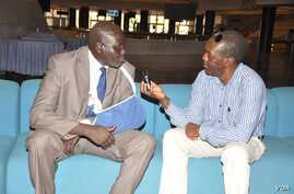 Aggrey Idris (arm in sling), interviewed by VOA's John Tanza Addis Ababa in 2015. (Photo: South Sudan in Focus)