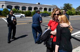 Jessica Parks, right, hugs Tina White outside the Chabad of Poway synagogue, April 27, 2019, in Poway, Calif., after a shooting occurred inside. At least one person was killed.