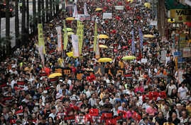 Protesters against an extradition law march along a downtown street in Hong Kong, April 28, 2019.