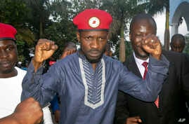 Ugandan pop star and opposition figure Bobi Wine, whose real name is Kyagulanyi Ssentamu, greets his followers as he arrives home after being released from prison on bail in Kampala, Uganda, May 2, 2019.
