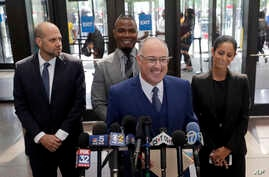 Steve Greenberg, R. Kelly's defense attorney, smiles as he responds to a question after Kelly pleaded not guilty on 11 new sex-related felonies in Chicago, June 6, 2019.