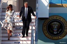 U.S. President Donald Trump and first lady Melania Trump arrive aboard Air Force One at Tokyo Haneda Airport in Tokyo, May 25, 2019.