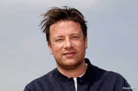 Chef Jamie Oliver poses during a photocall at the annual MIPCOM television program market in Cannes, France, Oct. 15, 2018.