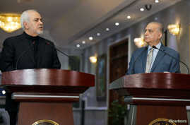 Iranian Foreign Minister, Mohammad Javad Zarif, speaks during a news conference with Iraqi Foreign Minister Mohamed Ali Alhakim in Baghdad, May 26, 2019.