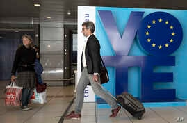 A man walks by an installation encouraging people to vote in the European elections at Luxembourg metro station in Brussels, May 24, 2019. About 400 million Europeans from 28 countries will head to the polls May 23-26 to choose lawmakers to represent...