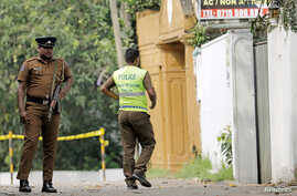 A Sri Lankan police officer walks into the motel where the Australian- and British-educated suicide bomber detonated his device inside, in Dehiwala on the outskirts of Colombo, Sri Lanka, April 26, 2019.