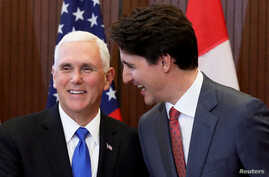 Canada's Prime Minister Justin Trudeau (R) and U.S. Vice President Mike Pence shake hands during a welcoming ceremony on Parliament Hill in Ottawa, Ontario, Canada, May 30, 2019.