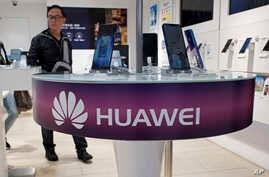 Huawei's mobile phones are displayed at a telecoms service shop in Hong Kong, March 29, 2019.