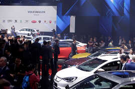 New cars are displayed at a Volkswagen Group's media event ahead of the Beijing Auto Show in Beijing, China, April 24, 2018.