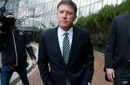 Bruce Isackson departs federal court in Boston, April 3, 2019, after facing charges in a nationwide college admissions bribery scandal.