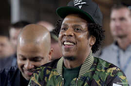 FILE - Recording artist Jay-Z attends a game at the Los Angeles Memorial Coliseum, Nov. 19, 2018.