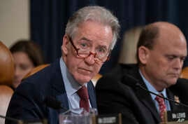FILE - House Ways and Means Committee Chairman Richard Neal, D-Mass., who is demanding President Donald Trump's tax returns for six years, is joined at right by Rep. Tom Reed, R-N.Y., at a hearing on taxpayer noncompliance on Capitol Hill in Washingt...