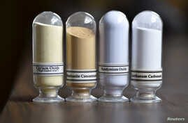 FILE - Samples of rare earth minerals from left, Cerium oxide, Bastnasite, Neodymium oxide and Lanthanum carbonate are on display during a tour of Molycorp's Mountain Pass Rare Earth facility in Mountain Pass, California, June 29, 2015.