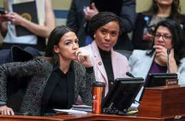 FILE - Rep. Alexandria Ocasio-Cortez, D-N.Y., left, joined by Rep. Ayanna Pressley, D-Mass., and Rep. Rashida Tlaib, D-Mich., listens during a House Oversight and Reform Committee meeting, on Capitol Hill in Washington, Feb. 26, 2019.