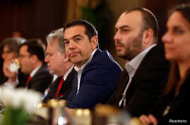 Greek Prime Minister Alexis Tsipras attends a trilateral summit with Cypriot President Nicos Anastasiades and Jordan's King Abdullah to expand cooperation in the East Mediterranean region, in Amman, Jordan, April 14, 2019.