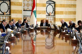 In this photo released by Lebanon's official government photographer Dalati Nohra, shows Lebanese President Michel Aoun, center, heading a cabinet meeting, at the presidential palace, in Baabda east of Beirut, Lebanon, Tuesday, April 30, 2019.