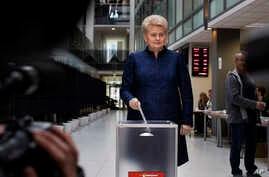 Lithuania's President Dalia Grybauskaite casts her ballot during early voting in Lithuania's presidential elections, at a polling station in Vilnius, Lithuania, May 7, 2019.