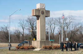 FILE - Visitors walk around the 40-foot Maryland Peace Cross dedicated to World War I soldiers.