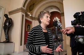 FILE - Rep. Jan Schakowsky, D-Ill., takes questions during a TV news interview before votes in the House, on Capitol Hill in Washington, May 10, 2019.