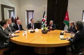 Presidential advisers Jared Kushner, center left, and Jason Greenblatt, third left, meet with Jordan's King Abdullah II, center right, and his advisers, in Amman, Jordan, Wednesday, May 29, 2019.