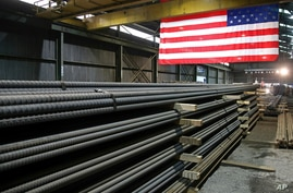 FILE -FILE - Steel rods await shipment at a mill in St. Paul, Minn., May 9, 2019.