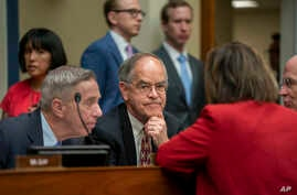 Rep. Jim Cooper, D-Tenn. (C), and Rep. Stephen F. Lynch, D-Mass. (L), confer with other Democrats as the House Oversight and Reform Committee considers whether to hold Attorney General William Barr and Commerce Sec. Wilbur Ross in contempt, June 12, 2019.