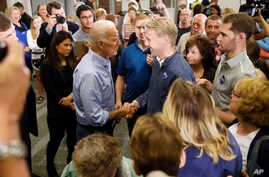 Former Vice President Joe Biden talks to Iowa voters
